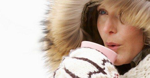 Woman holding warm drink in winter